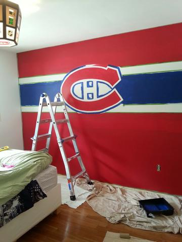 The Montreal Canadiens mural in progress being painted by Adrienne of AboutMurals.ca