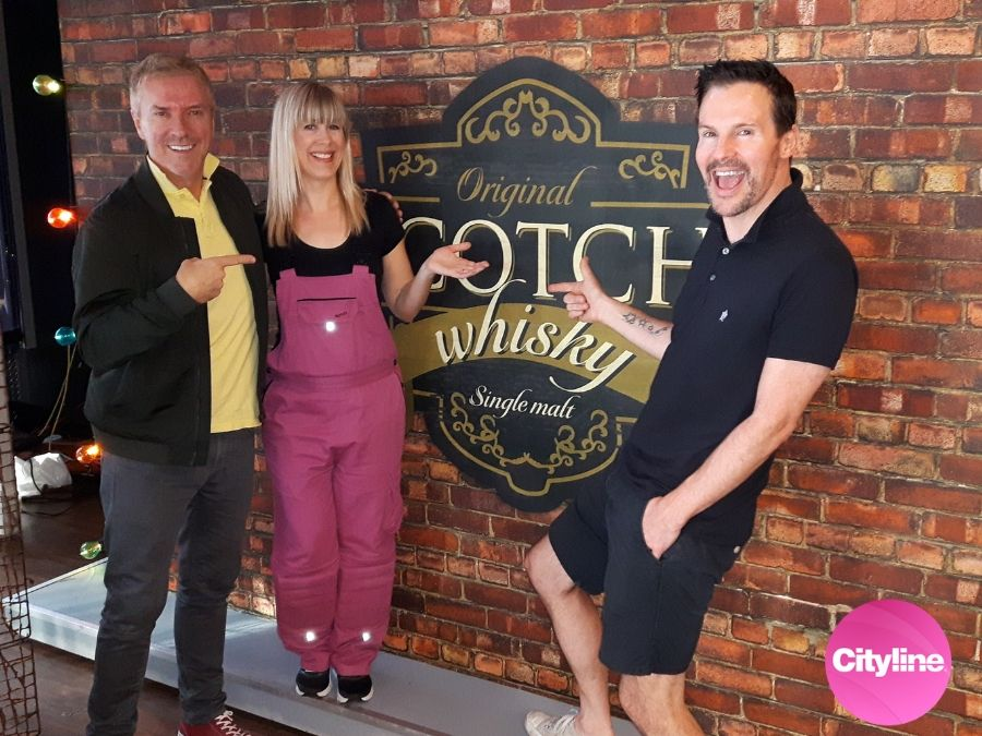Adrienne from AboutMurals.ca installed Old Brick Wall Mural for Colin and Justin on set at Cityline