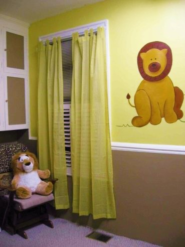 An animals mural featuring a lion painted by Adrienne of AboutMurals.ca