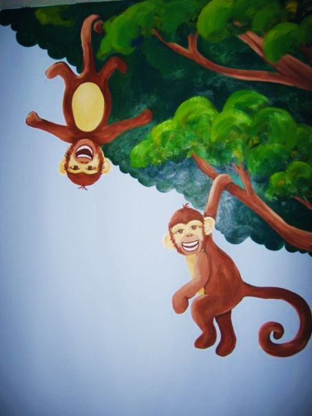 A jungle wall mural featuring monkeys, painted by Adrienne of AboutMurals.ca