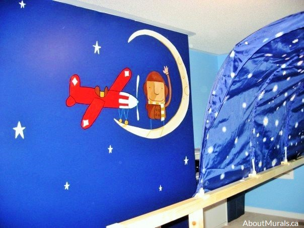 A space wall mural painted by Adrienne of AboutMurals.ca