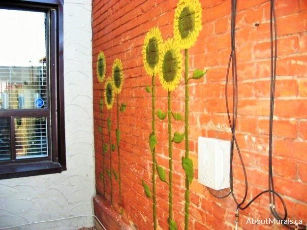 A sunflower mural painted by Adrienne of AboutMurals.ca
