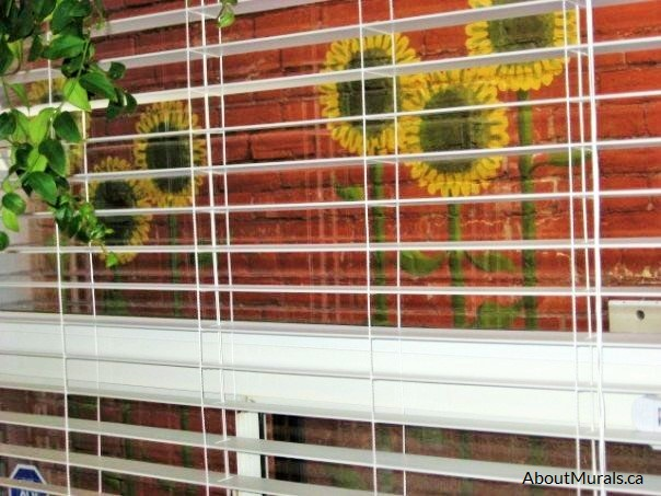 The view of a sunflower mural from a kitchen window, painted by Adrienne of AboutMurals.ca