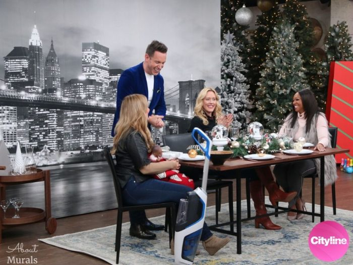 A removable wallpaper featuring the Brooklyn Bridge is the backdrop to a dining room scene on set at Cityline with Tracy Moore, Shai DeLuca, Shoana Jensen and Karen Sealy, by AboutMurals.ca