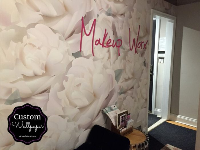 A custom wallpaper featuring the Makeup Worx logo over floral wallpaper, created by AboutMurals.ca