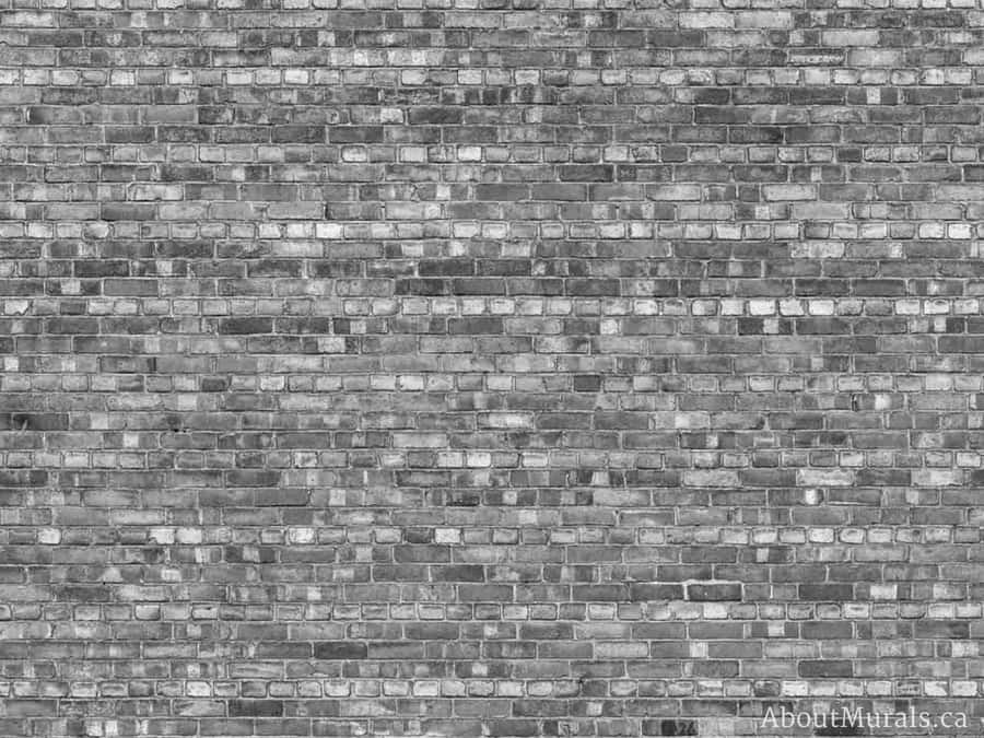 A grey brick wallpaper sold by AboutMurals.ca