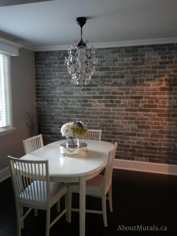 A grey brick wallpaper in a dining room, sold by AboutMurals.ca