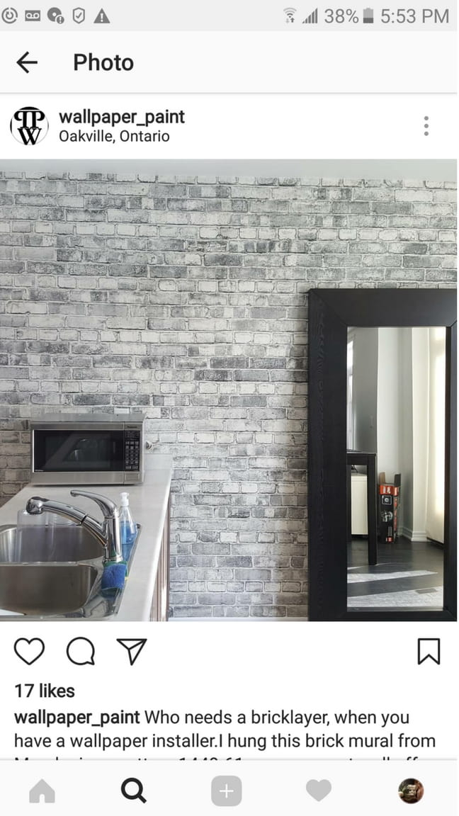 A grey brick wallpaper in a kitchen, sold by AboutMurals.ca