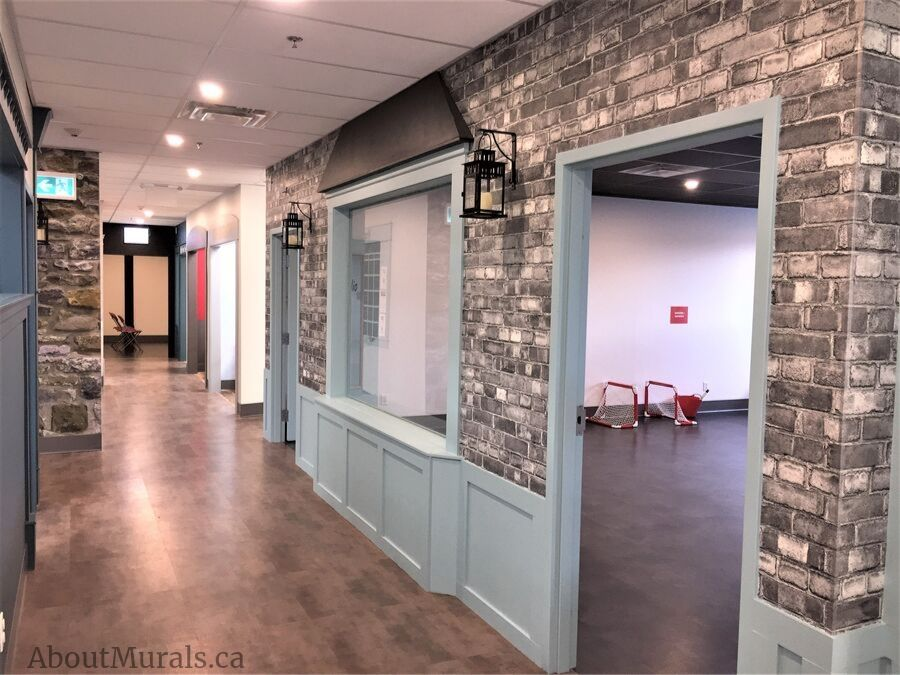 A grey brick wallpaper, sold by AboutMurals.ca, in the corridor of The Pearl Hummingbird in Hamilton, Ontario