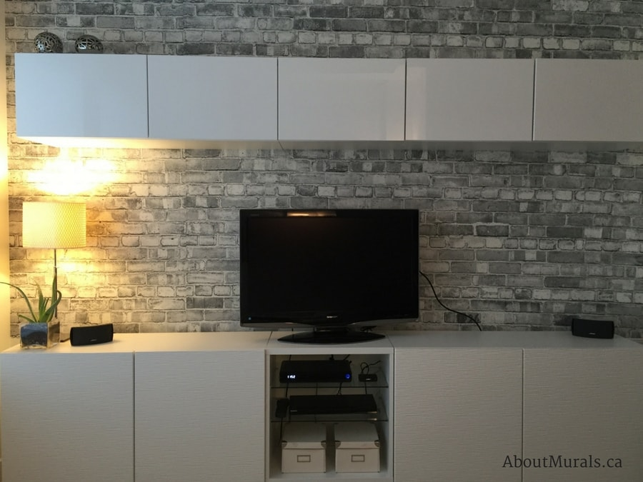A grey brick wallpaper in a TV room, sold by AboutMurals.ca
