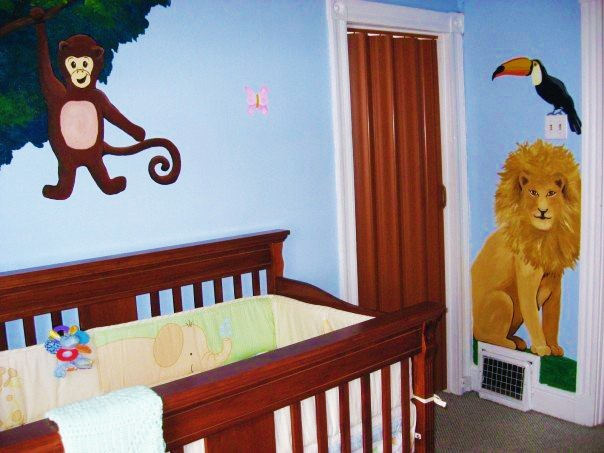 A jungle mural featuring a monkey, lion and toucan, painted by Adrienne of AboutMurals.ca