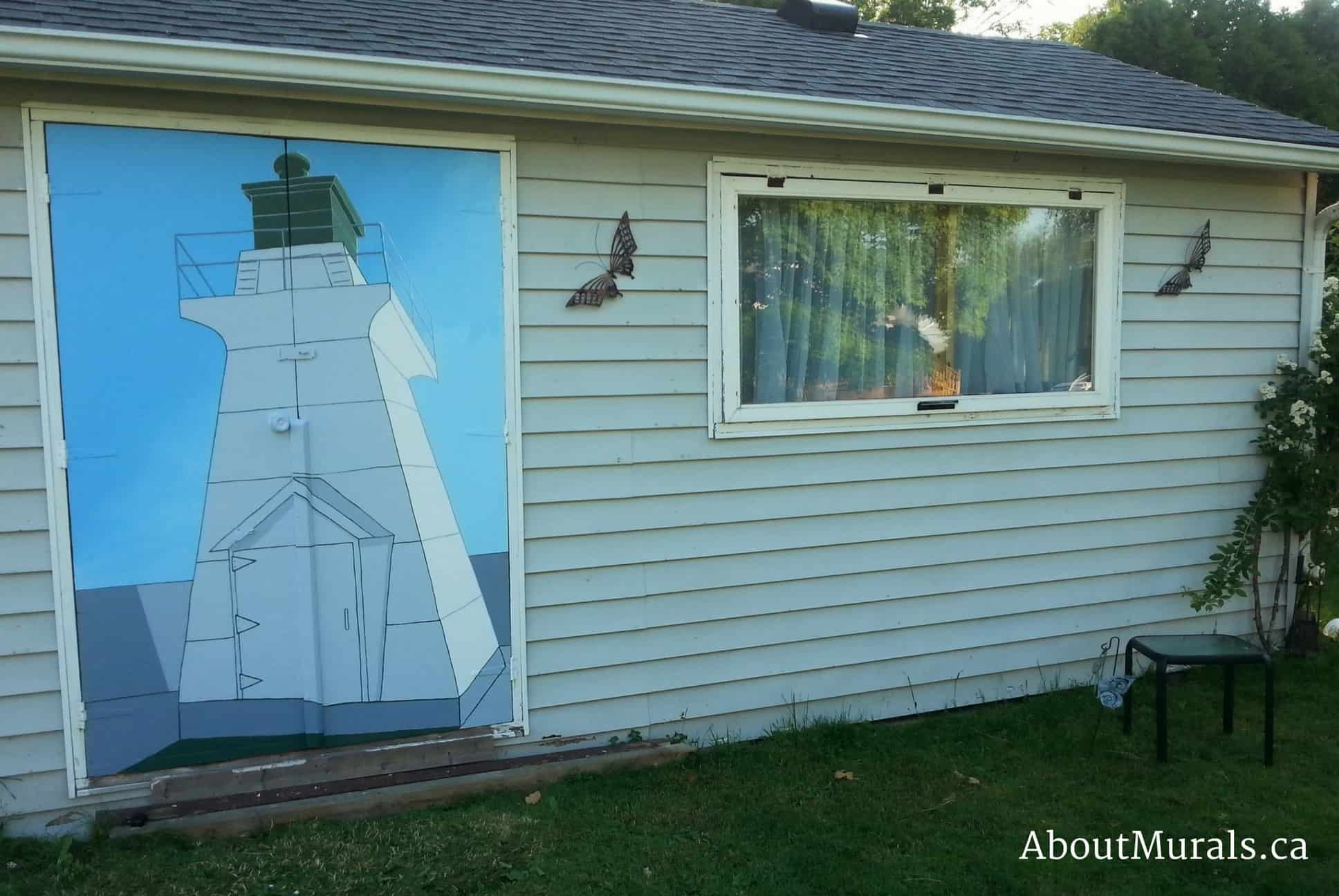A lighthouse mural painted on the side of a garden shed in Port Dover
