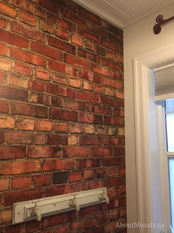 A red brick wallpaper in a bathroom with faucet hooks