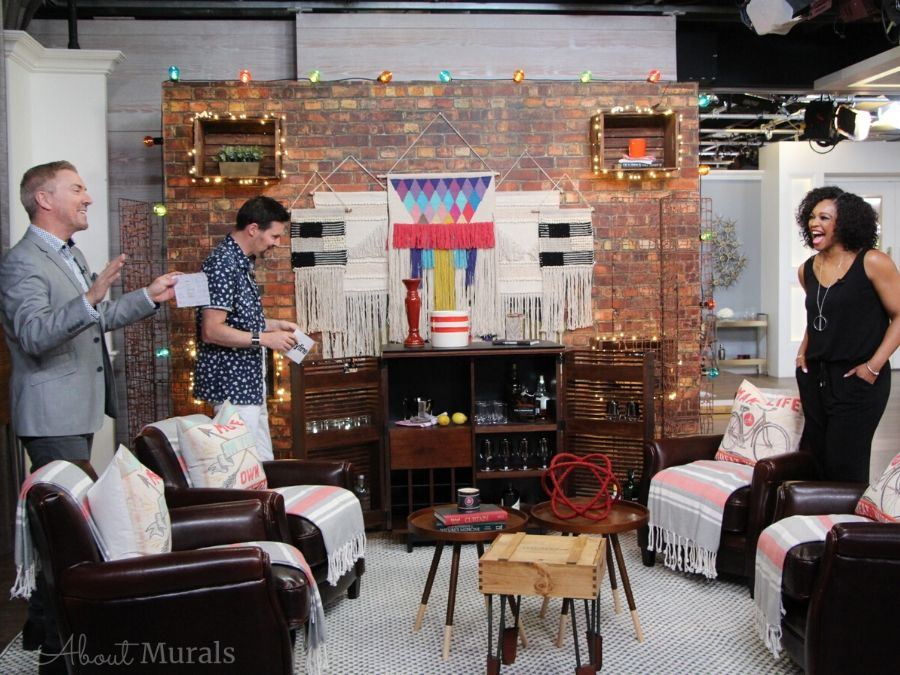 A faux brick wallpaper on set at Cityline with Tracy Moore, Colin and Justin