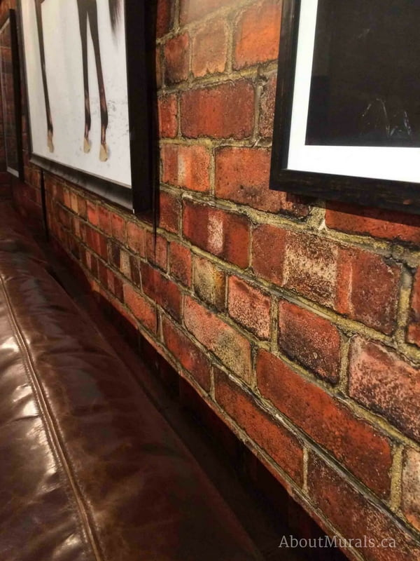 A red brick wallpaper in a living room
