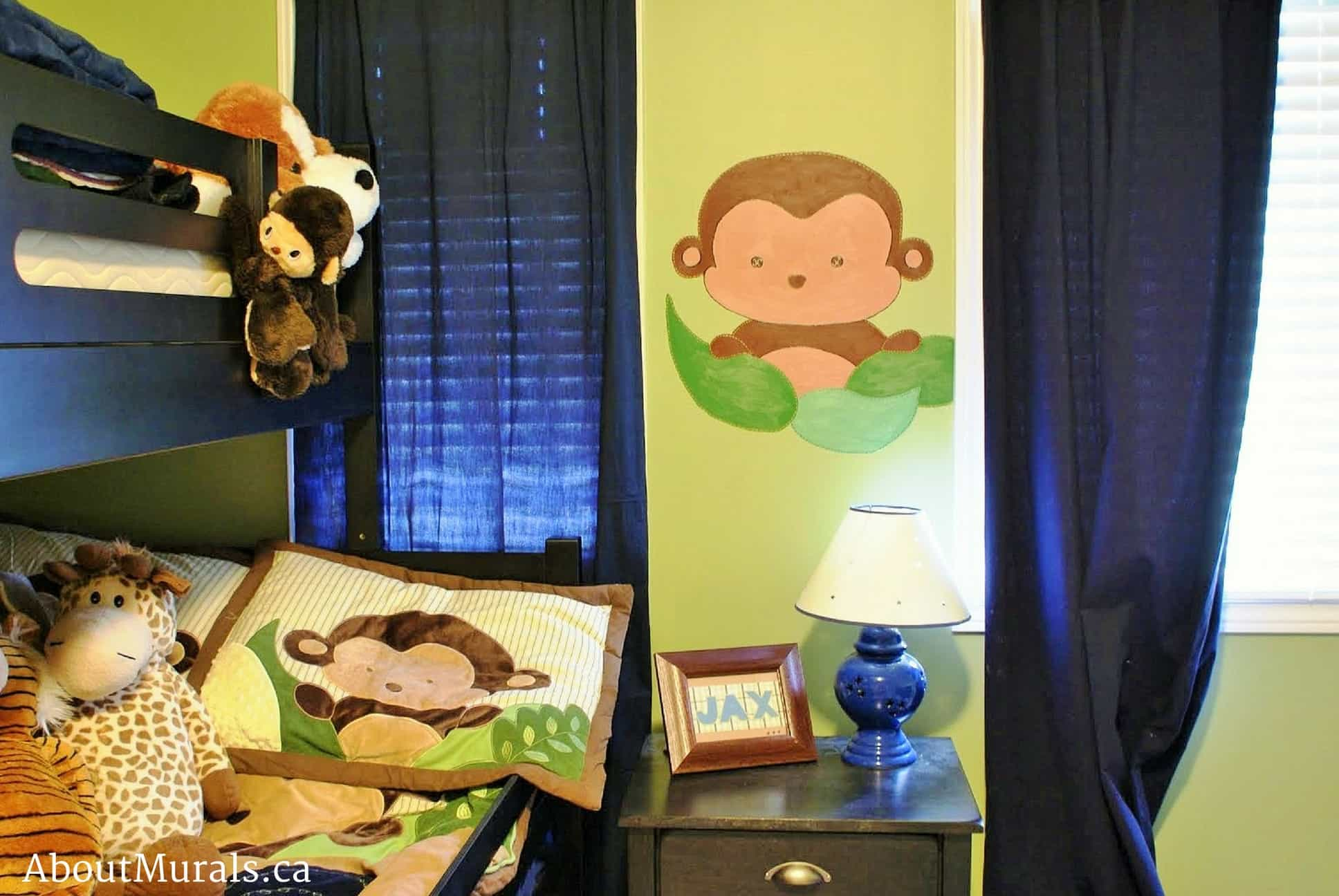 A kids wall mural featuring a monkey hiding behind leaves