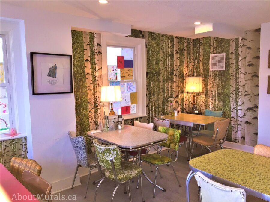 A green birch wallpaper in a restaurant, sold and hung by AboutMurals.ca