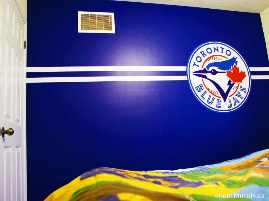 A baseball mural of a Toronto Blue Jays logo, painted by Adrienne of AboutMurals.ca