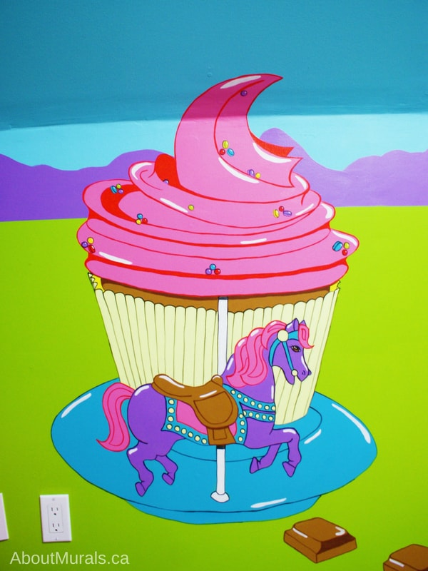 Adrienne of AboutMurals.ca painted a cupcake carousel with a purple horse in this kids mural