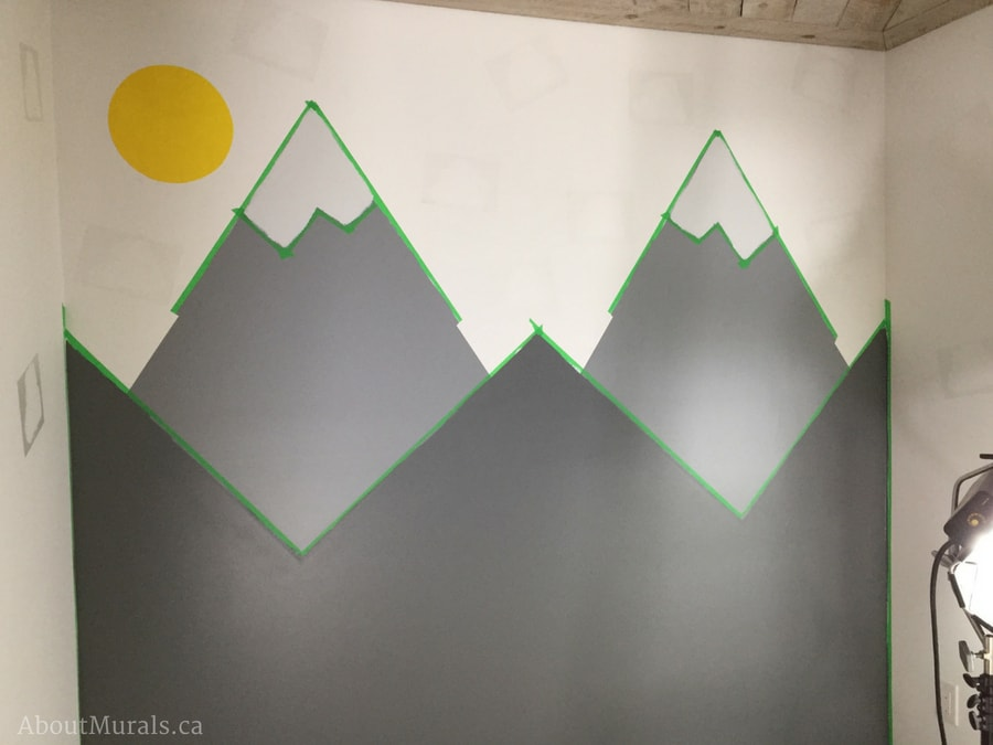 DIY mountain mural by painting the lower mountains in dark grey like Adrienne of AboutMurals.ca