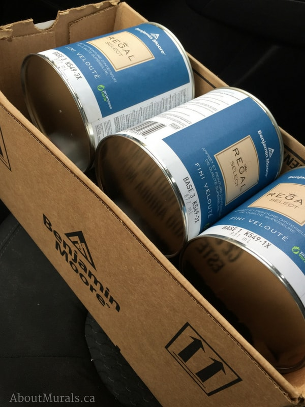 Cans of Benjamin Moore paint
