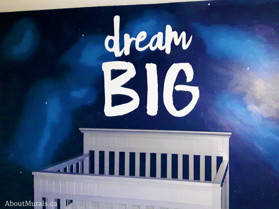 A Dream Big mural painted on an outer space background for a baby by Adrienne of AboutMurals.ca