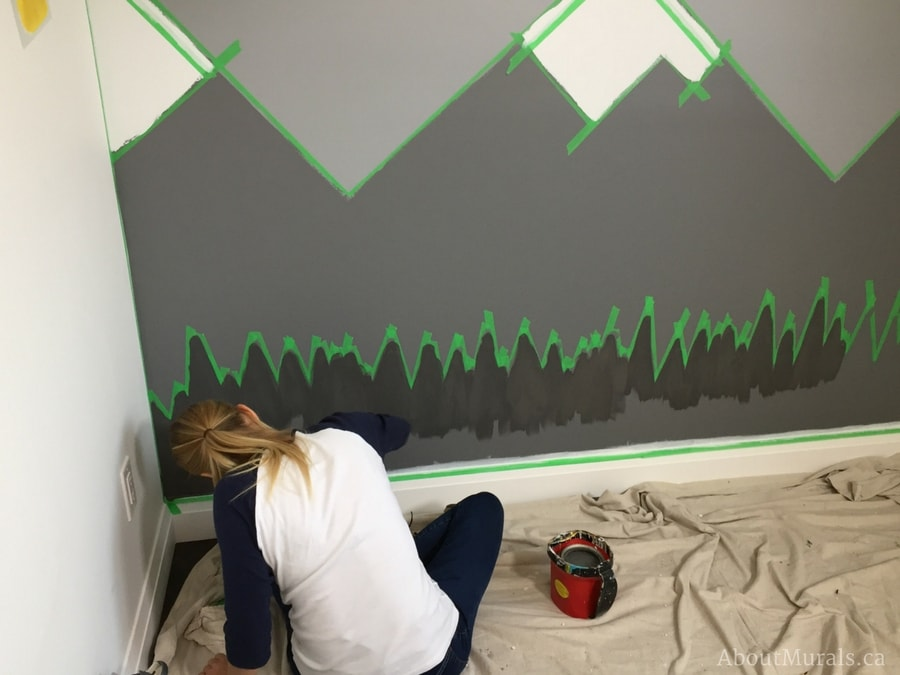 Holmes Next Generation star, Sherry Holmes, learns how to paint a mountain mural from Adrienne of AboutMurals.ca