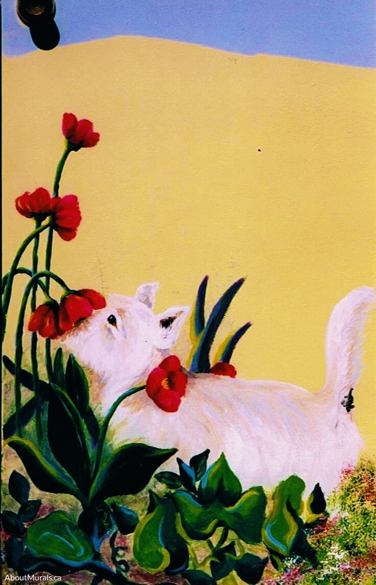 A dog sniffing a tulip is painted in a garden mural by Adrienne of AboutMurals.ca
