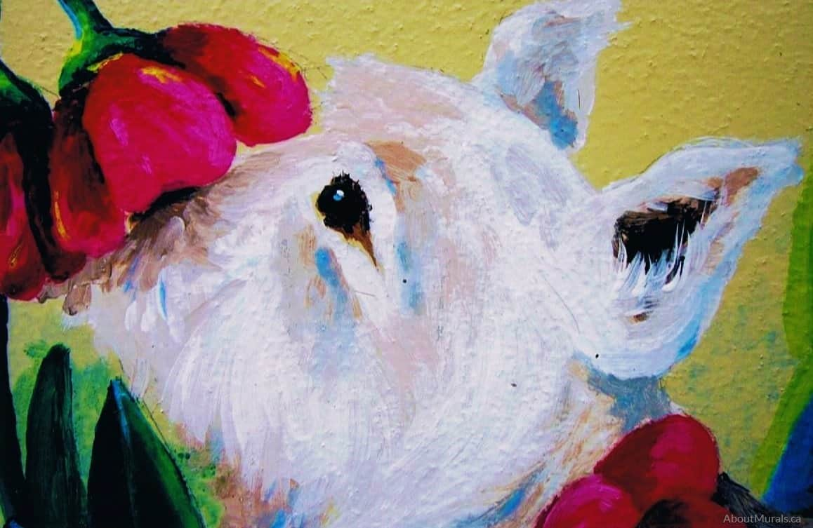 A closeup of a white dog sniffing a tulip in a garden mural painted by Adrienne of AboutMurals.ca