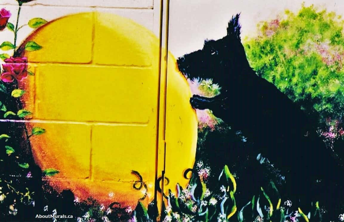 A dog pushes an exercise ball in a garden mural painted by Adrienne of AboutMurals.ca