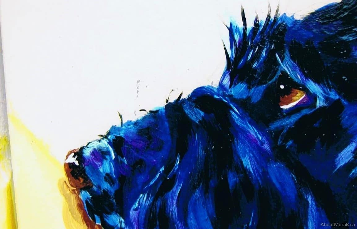 A closeup of a black dog painted in a garden mural by Adrienne of AboutMurals.ca