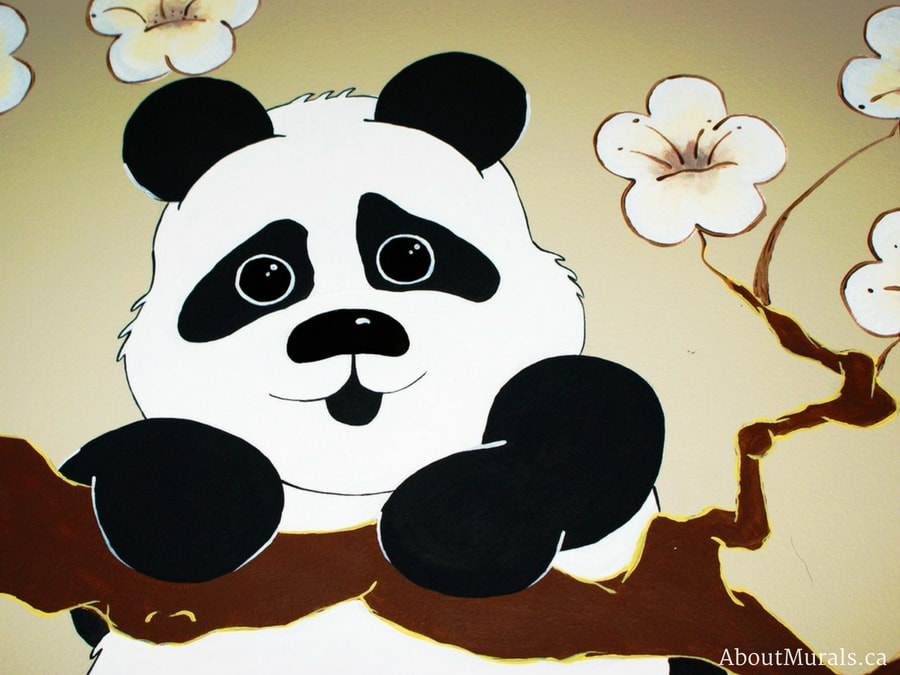 A closeup of a panda mural painted by Adrienne of AboutMurals.ca
