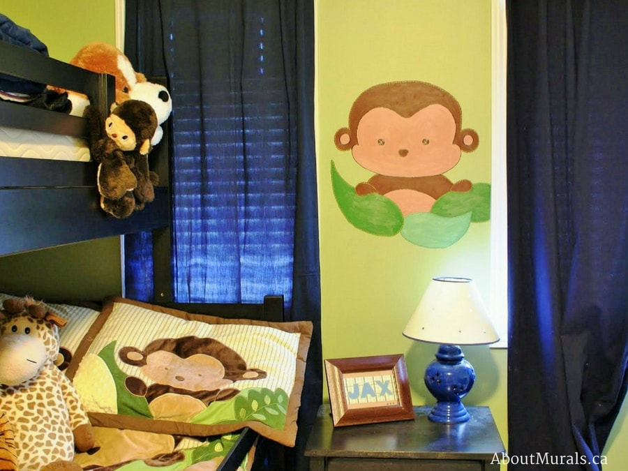 A safari mural featuring a monkey peeking from behind leaves, painted by Adrienne of AboutMurals.ca