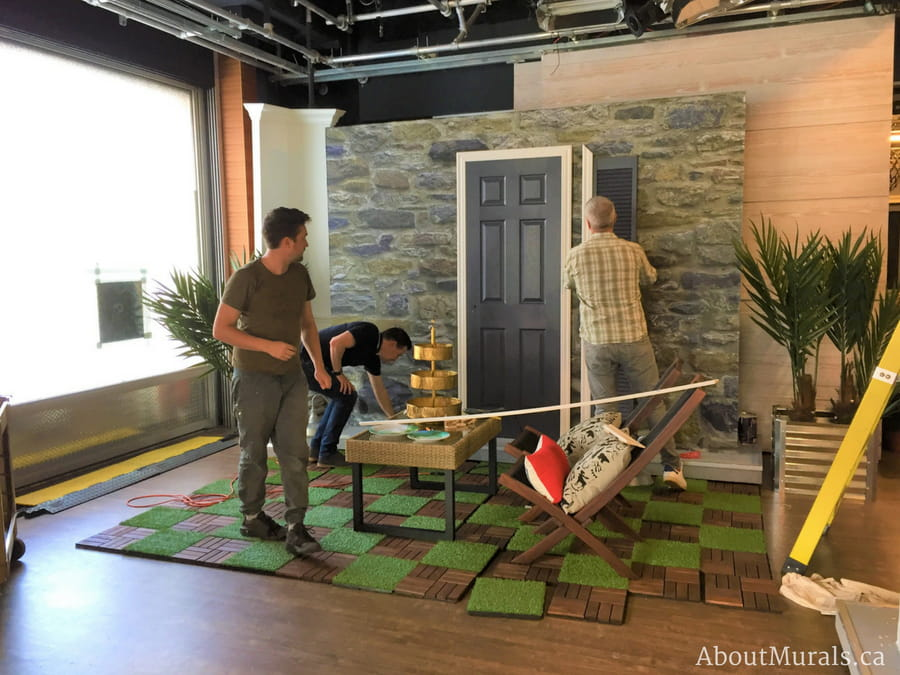 Colin and Justin work around a stone wallpaper on Cityline, supplied by AboutMurals.ca