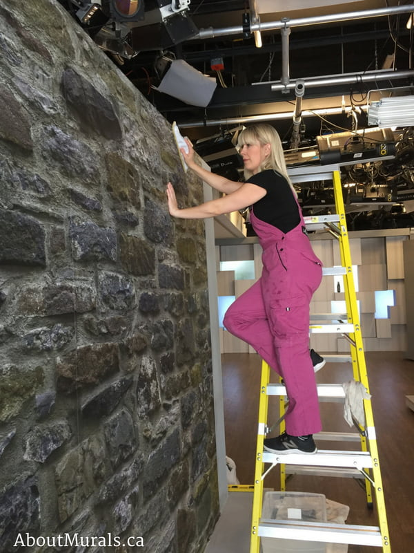 Adrienne of AboutMurals.ca hangs a stone wallpaper on Cityline