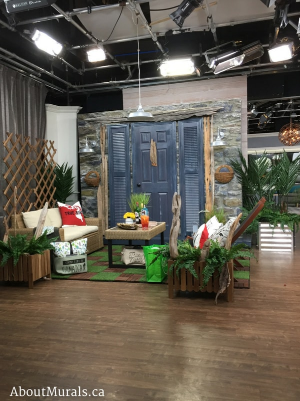 A veranda oasis, created by Colin and Justin, with stone wallpaper on Cityline by AboutMurals.ca