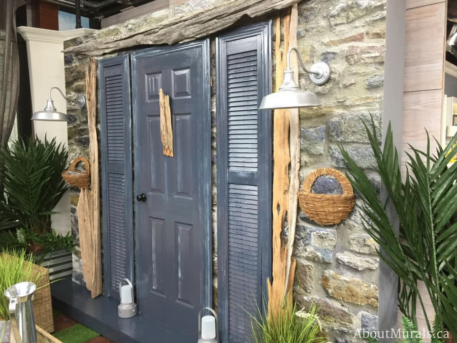 A photo of stone wallpaper on Cityline with rustic driftwood and a moody blue door