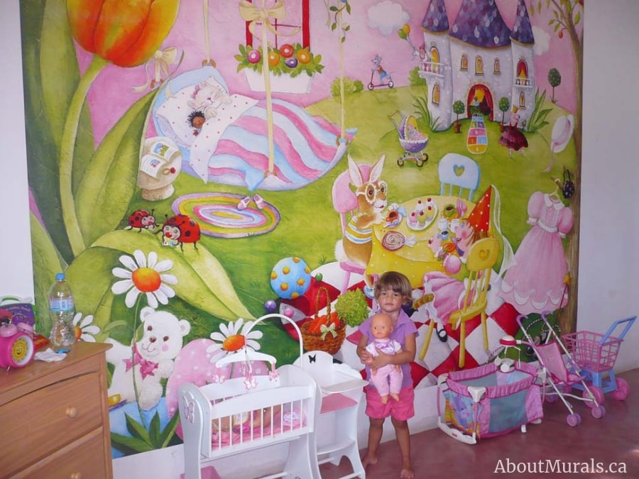 A little girl stands in front of a tea party mural sold by AboutMurals.ca