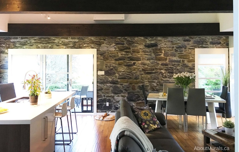 A stone wallpaper in a living room, sold by AboutMurals.ca
