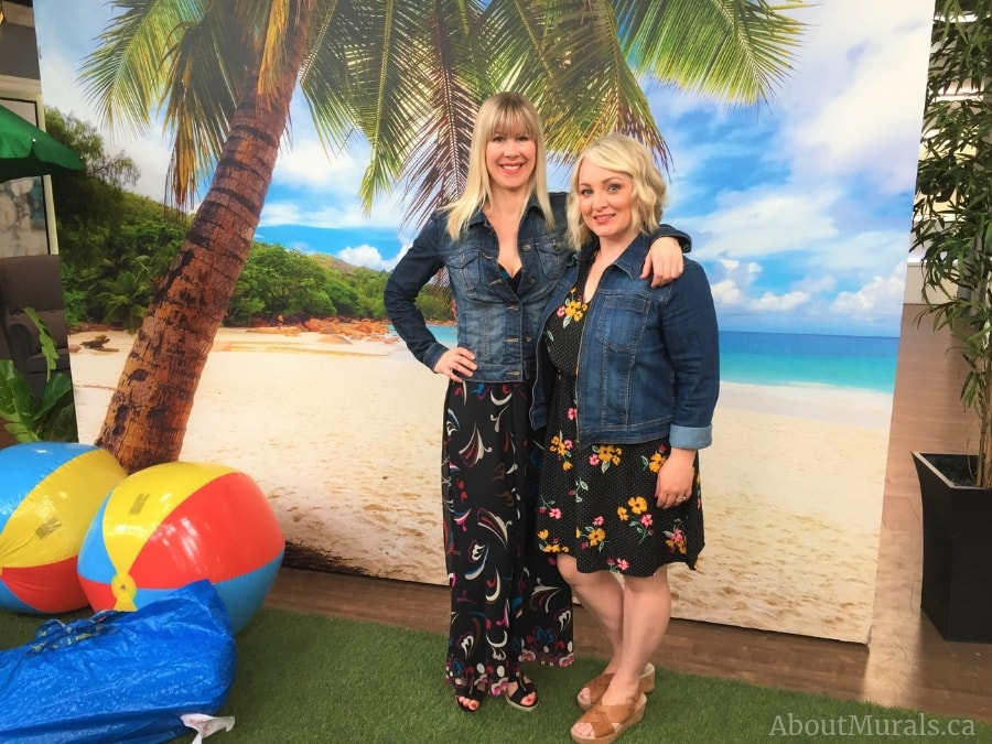 Leigh-Ann Allaire Perrault and Adrienne of AboutMurals.ca stand in front of her Beach Mural on Cityline