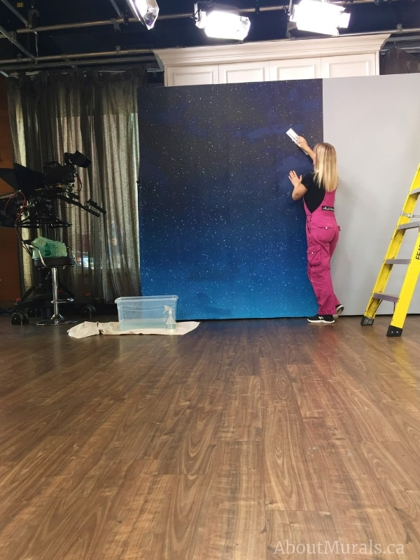Adrienne of AboutMurals.ca hangs this Moon and Stars Wallpaper on set at Cityline