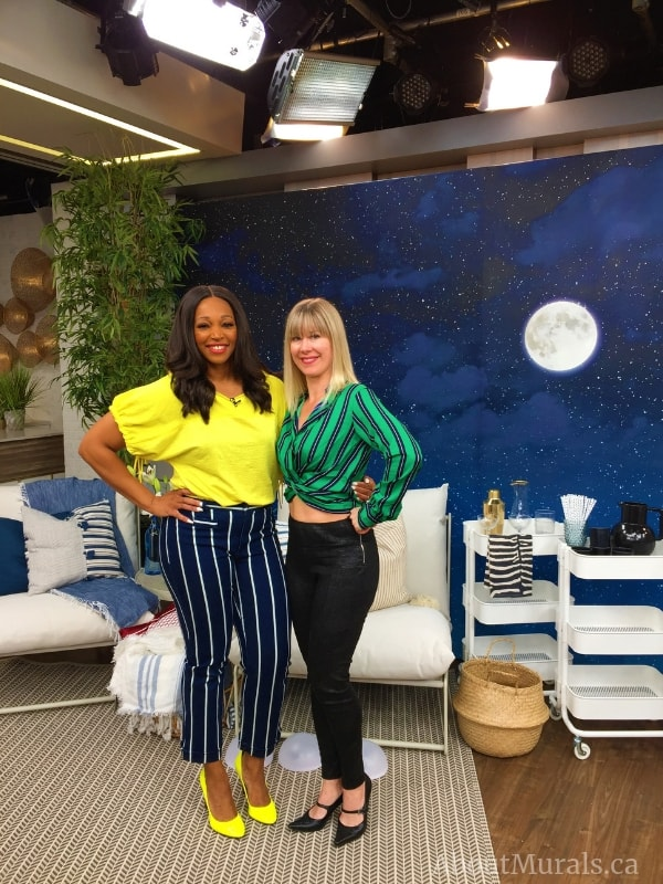 Tracy Moore and Adrienne of AboutMurals.ca standing in front of Moon and Stars Wallpaper on Cityline