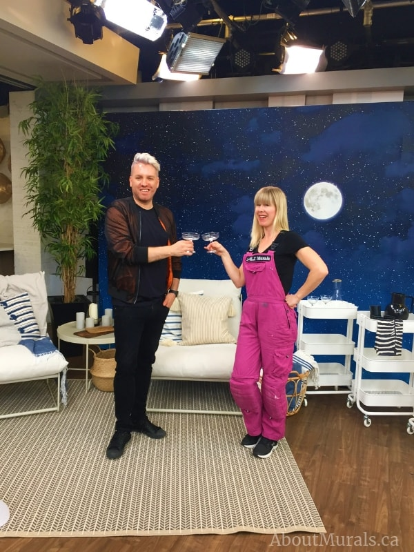 Christian Dare and Adrienne of AboutMurals.ca stand in front of the Moon and Stars Wallpaper on Cityline