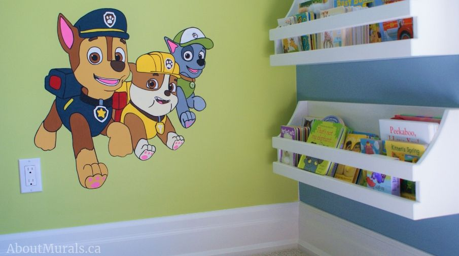 Muralist Adrienne painted Chase, Rubble and Rocky in this Paw Patrol bedroom.