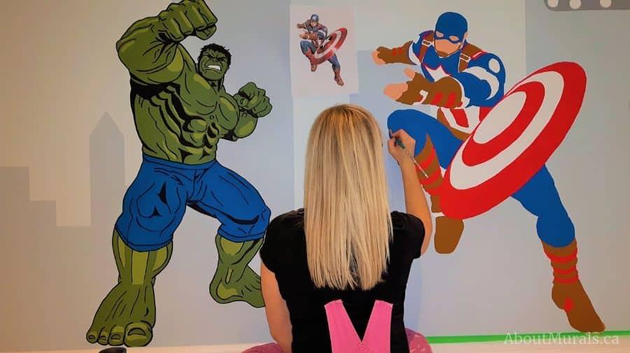 Muralist Adrienne Scanlan paints Captain America and the Hulk