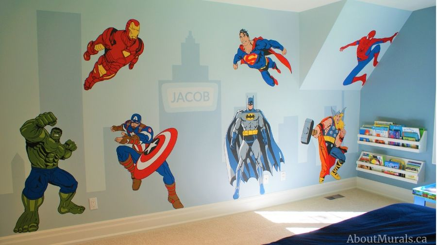 A superhero room painted by Adrienne of AboutMurals.ca featuring the Hulk, Iron Man, Captain America, Batman, Superman, Spiderman and Thor