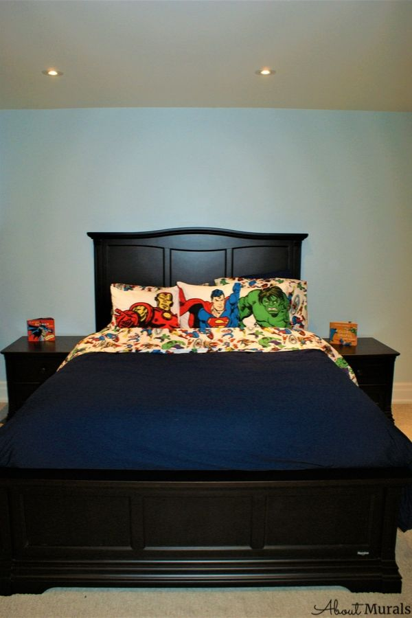 A bed in a superhero room