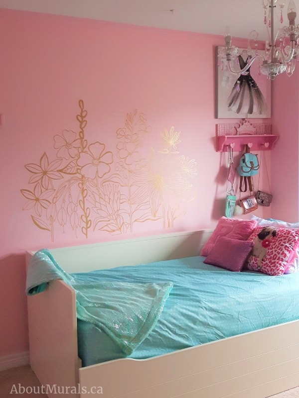 A shimmery wildflower mural in a pink bedroom, painted by Adrienne of AboutMurals.ca