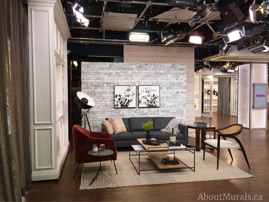 A gray brick wallpaper from AboutMurals.ca is the backdrop to Brian's Gluckstein's set on Cityline