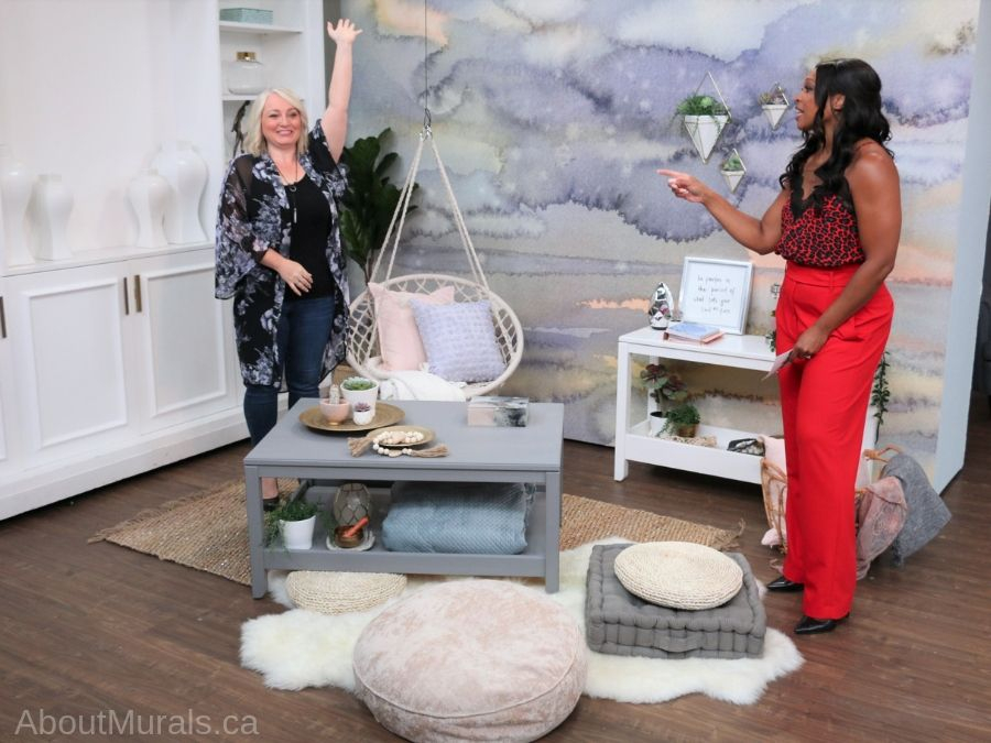 Leigh-Ann Allaire Perrault and Tracy Moore stand in front of a meditation room wallpaper by AboutMurals.ca on set at Cityline